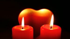 stock-footage-a-concept-of-love-red-candles-and-heart-behind